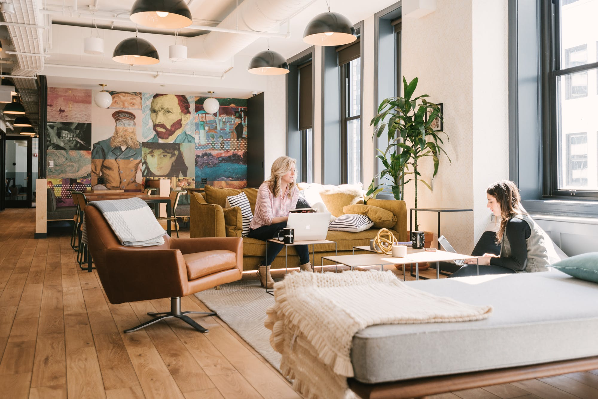 people sitting in a sunny  Wework area