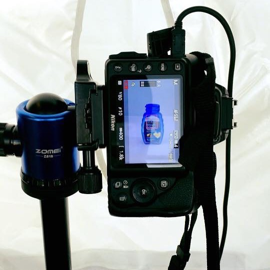 picture of a DSLR camera taking a picture of a pill bottle