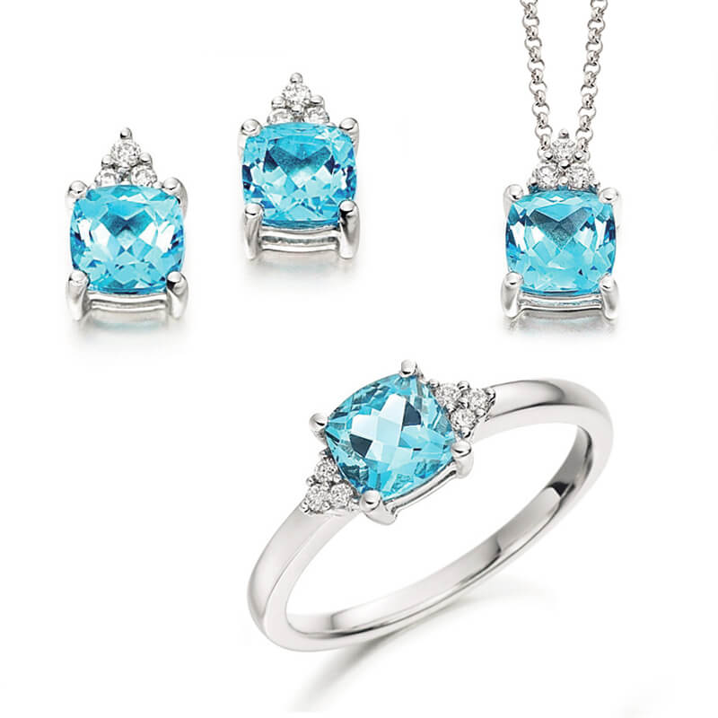Jewellery suite of pendant, earrings and ring in white gold with gemstones