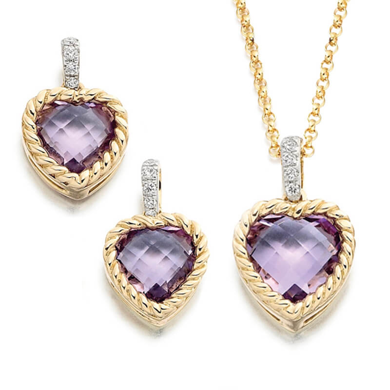 Jewellery suite of pendant and earrings in yellow gold with gemstones