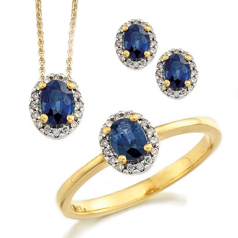 Jewellery suite of pendant, earrings and ring in yellow gold with gemstones