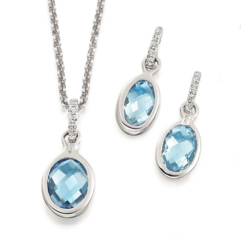 Jewellery suite of pendant and earrings in white gold with gemstones