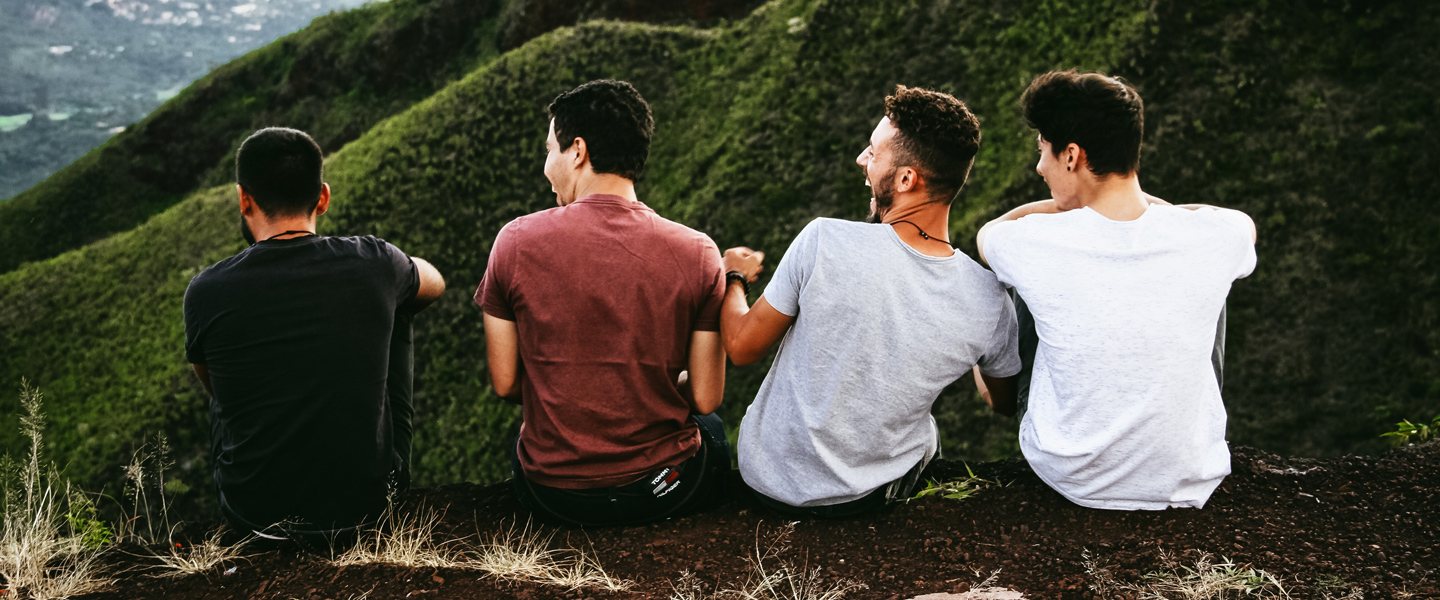 Header image of four men on a hill