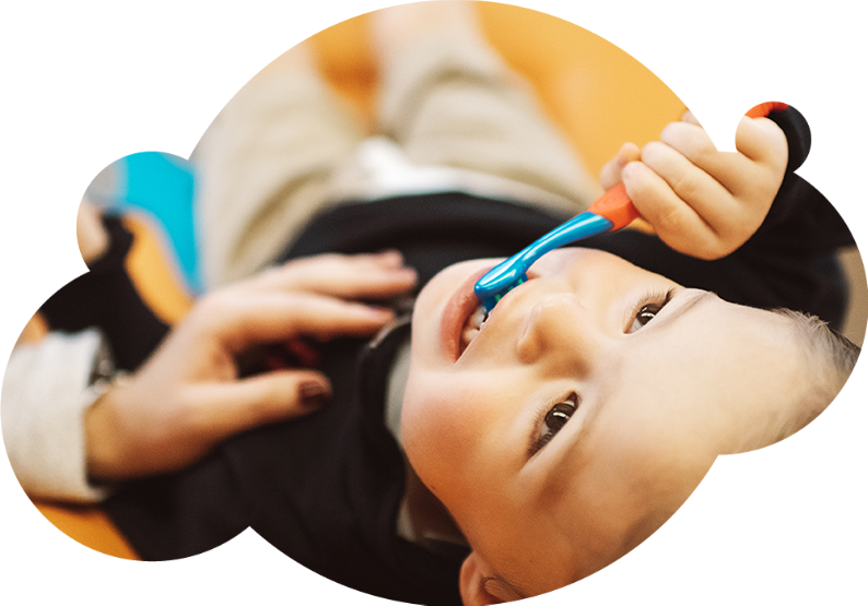 Photo of a young patient brushing his teeth