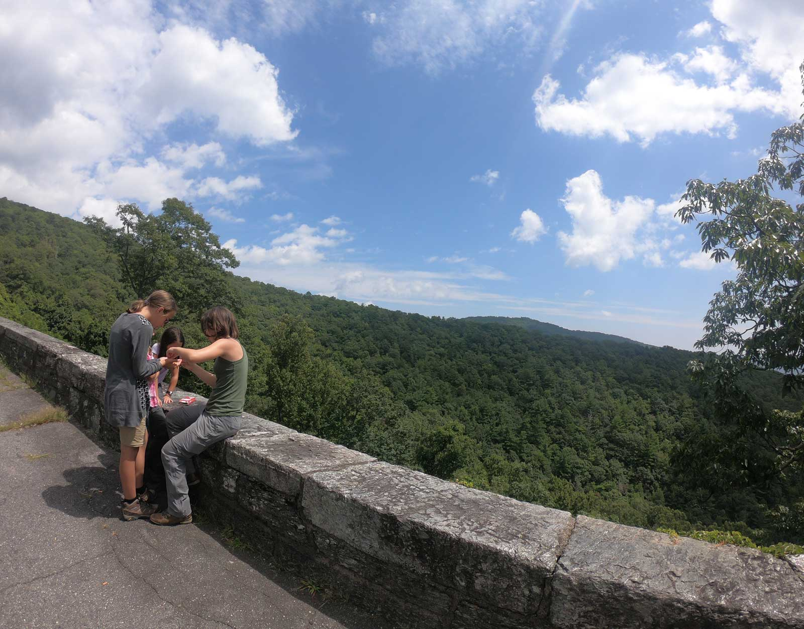 Photo of three girls at an overlook on the Blue Ridge Parkway near Black Mountain Campground, North Carolina