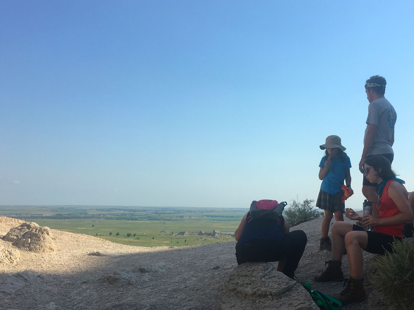 Family taking a break while overlooking the White River Valley in the Badlands National Park of South Dakota