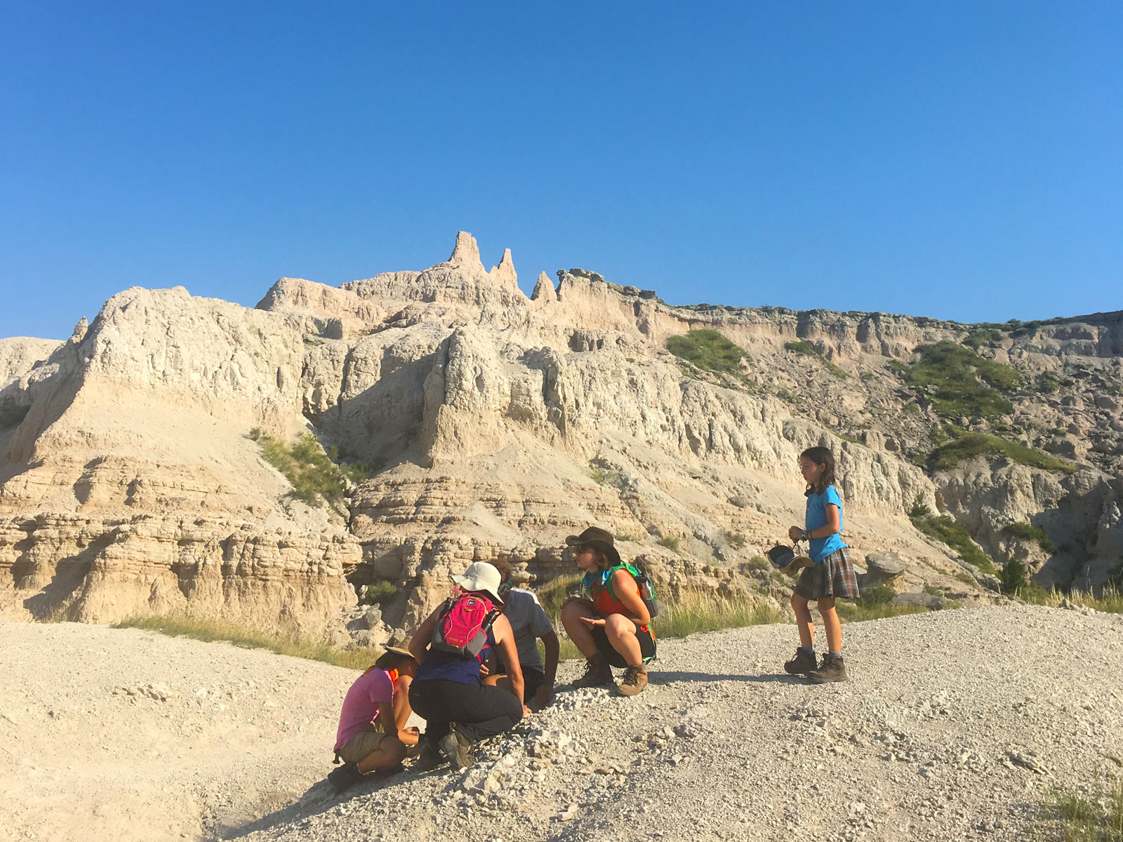 Family resting on a hike in Badlands National Park, South Dakota