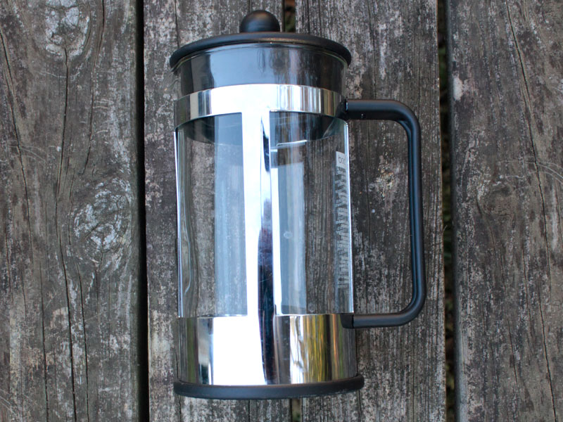 Image of a French Press style coffee maker at a camp site