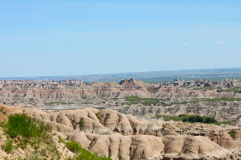 South Dakota Badlands National Park landscape overlook image of buttes and canyons with blue sky