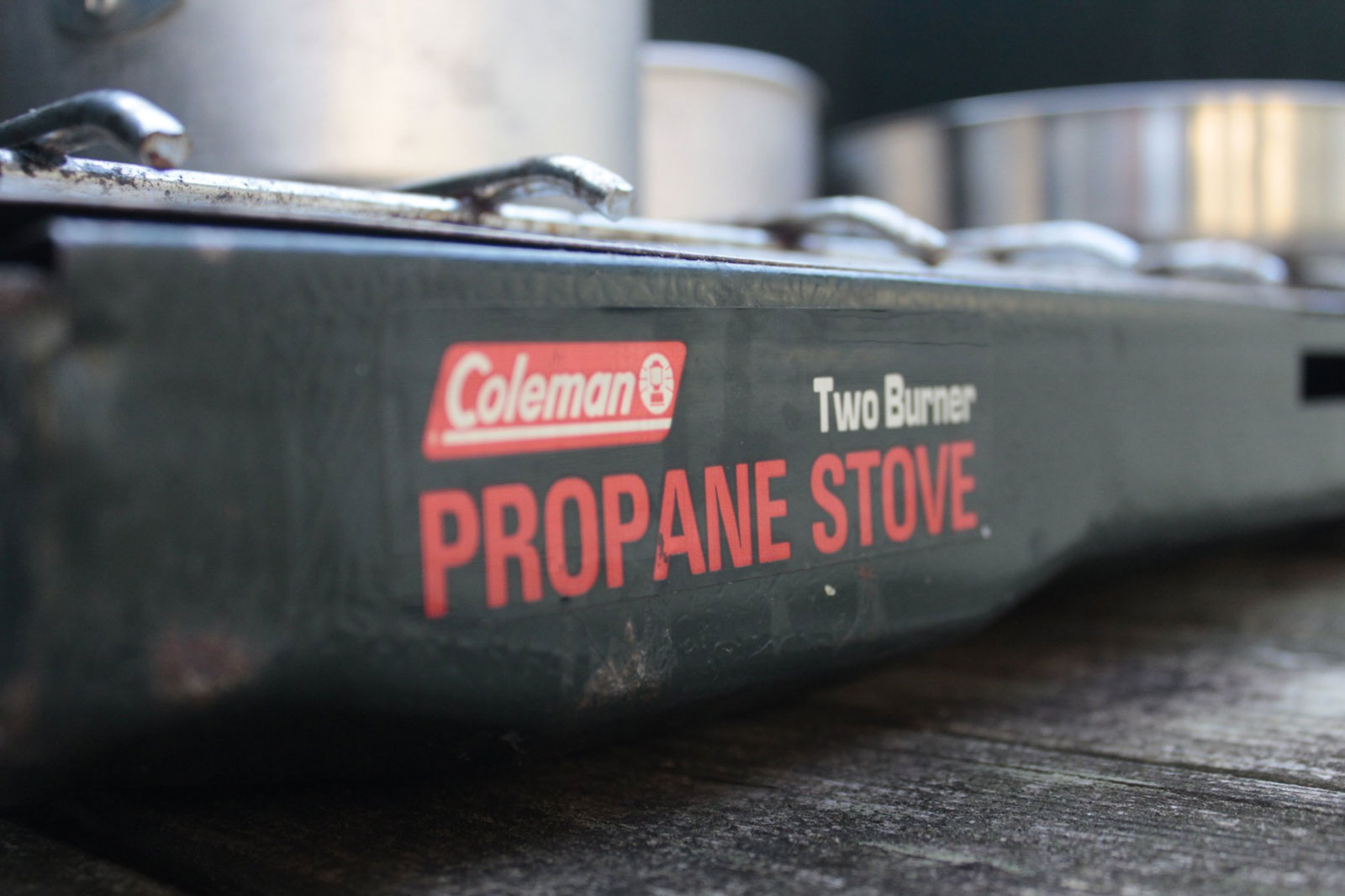 Close up photo of a Coleman Propane Gas stove at a campsite