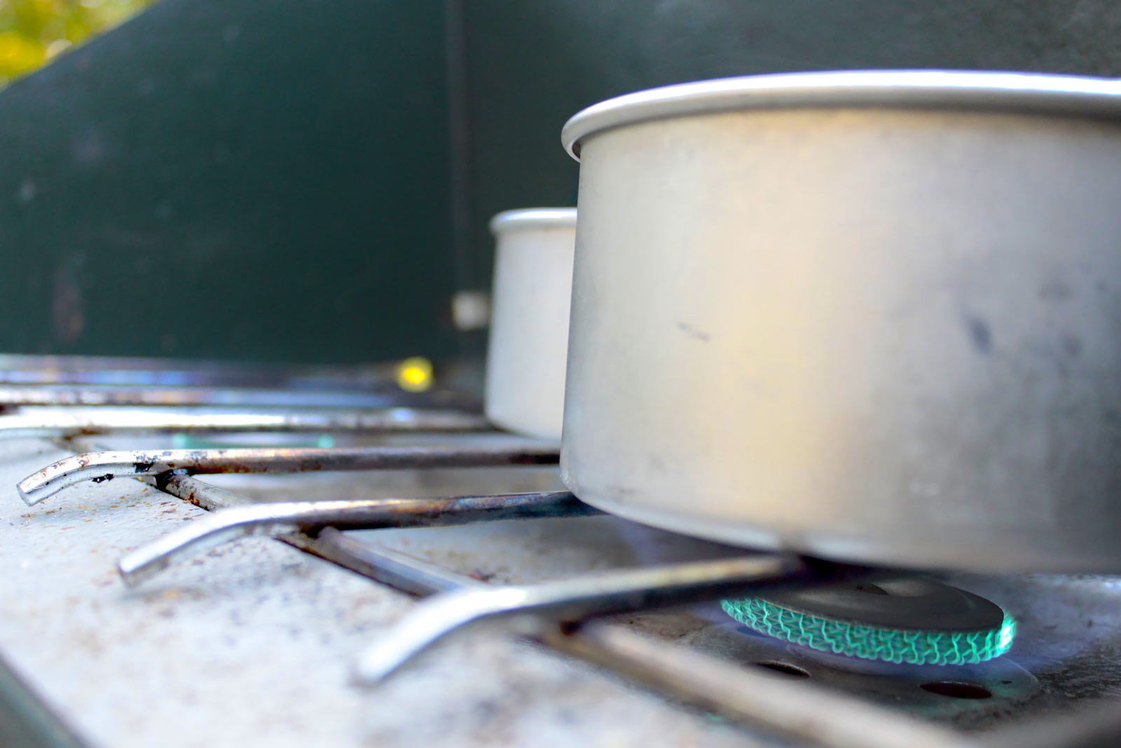 Photo of a lit propane gas burner of a Coleman camp stove.