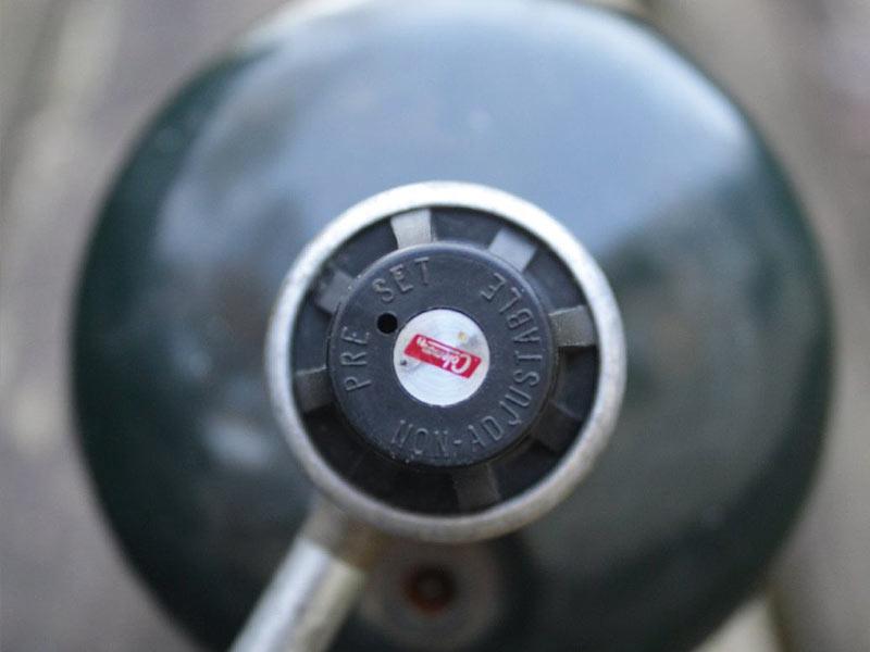 Close up photo of a Coleman Propane Gas Stove propane tank
