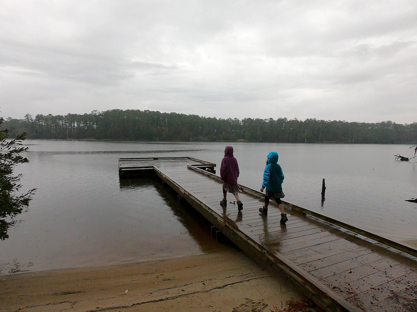 Two girls on overcast day at boating ramp and dock at Goose Creek State Park Campground Road access