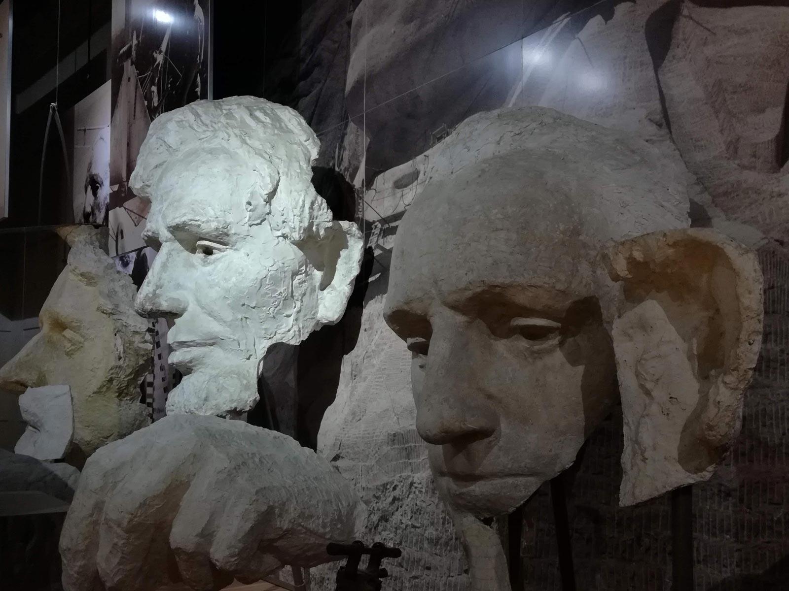 Visitor center museum replicas of Mount Rushmore faces