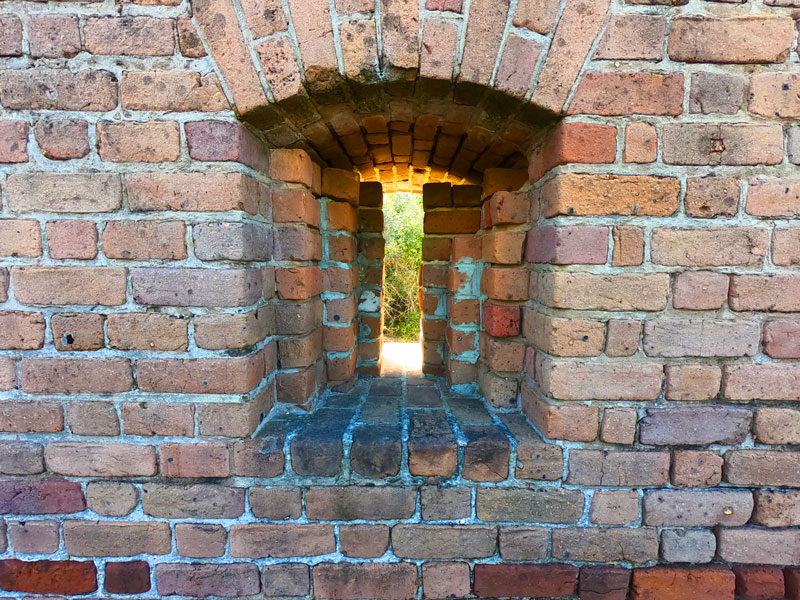 Looking through a brick gun portal at historic Fort Clinch State Park, Florida, on Amelia Island