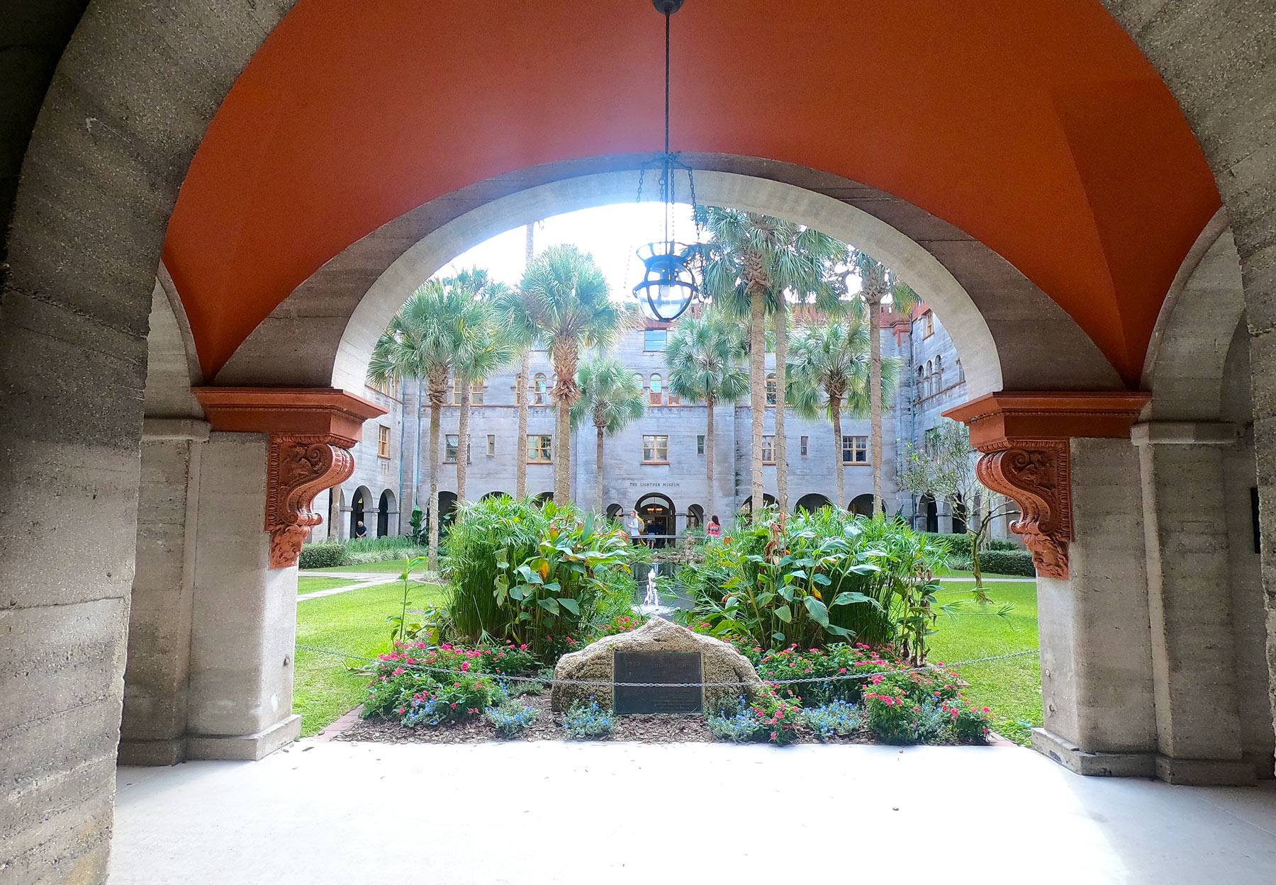 Arched brick walkway entrance to Lightner Museum courtyard in St Augustine, Florida