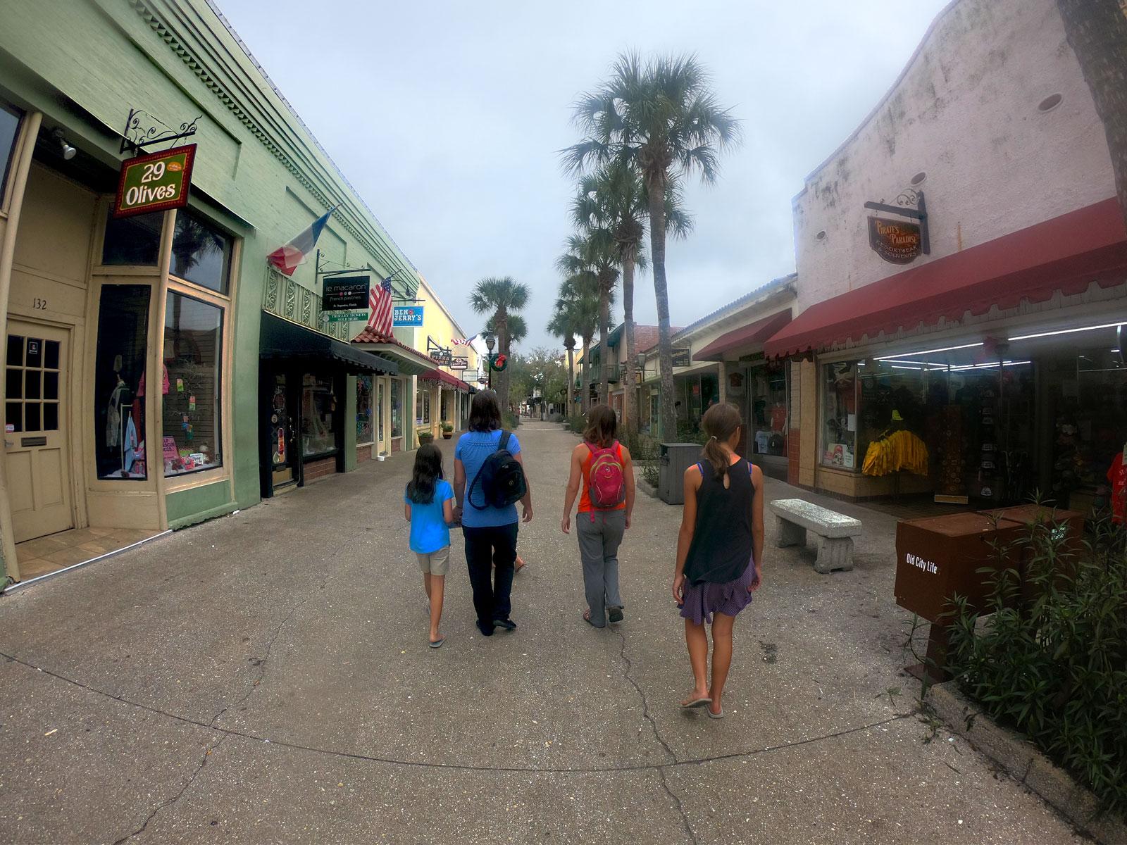 Four people walking down St. George Street in Saint Augustine, Florida