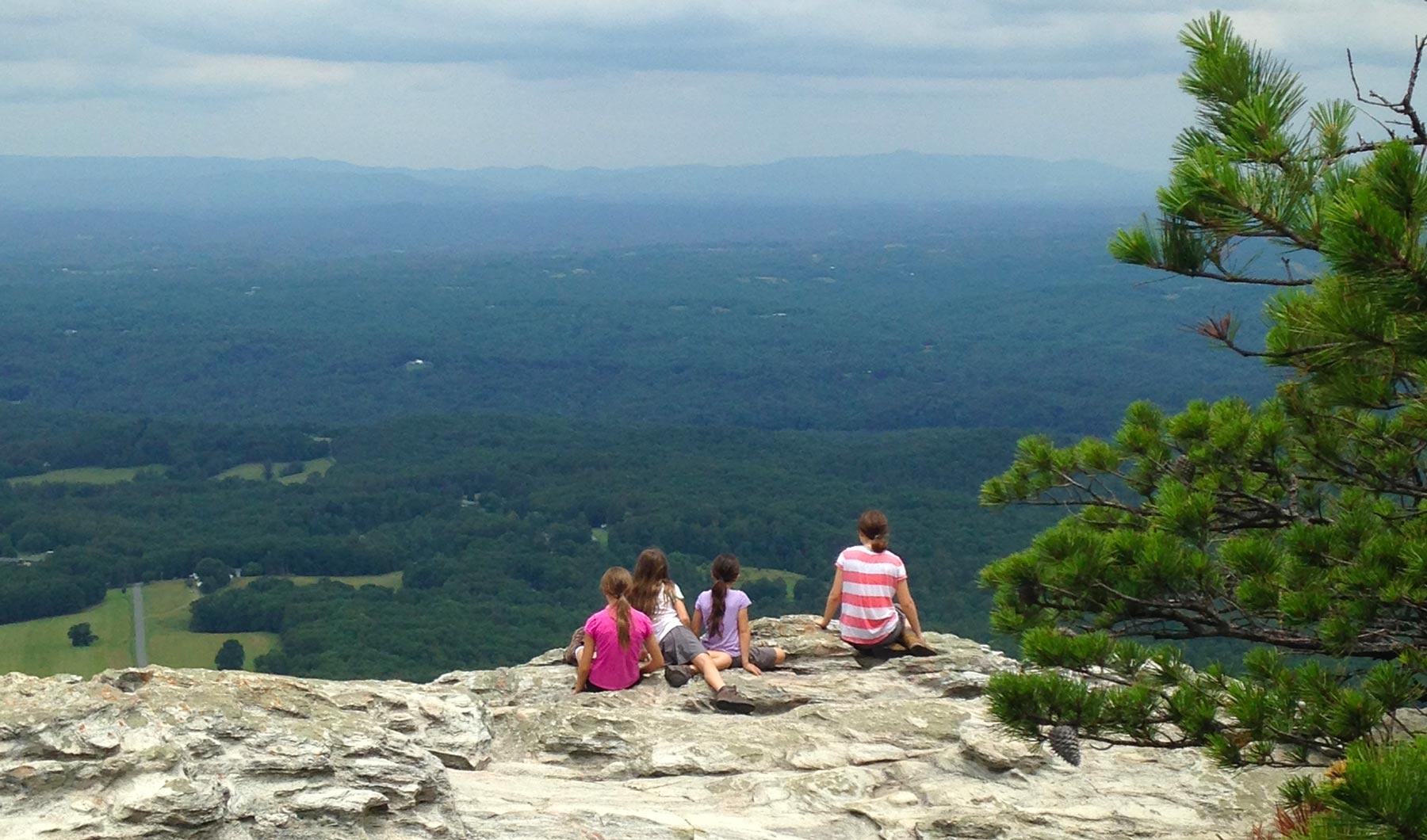 Four girls at pinnacle in Hanging Rock State Park, North Carolina