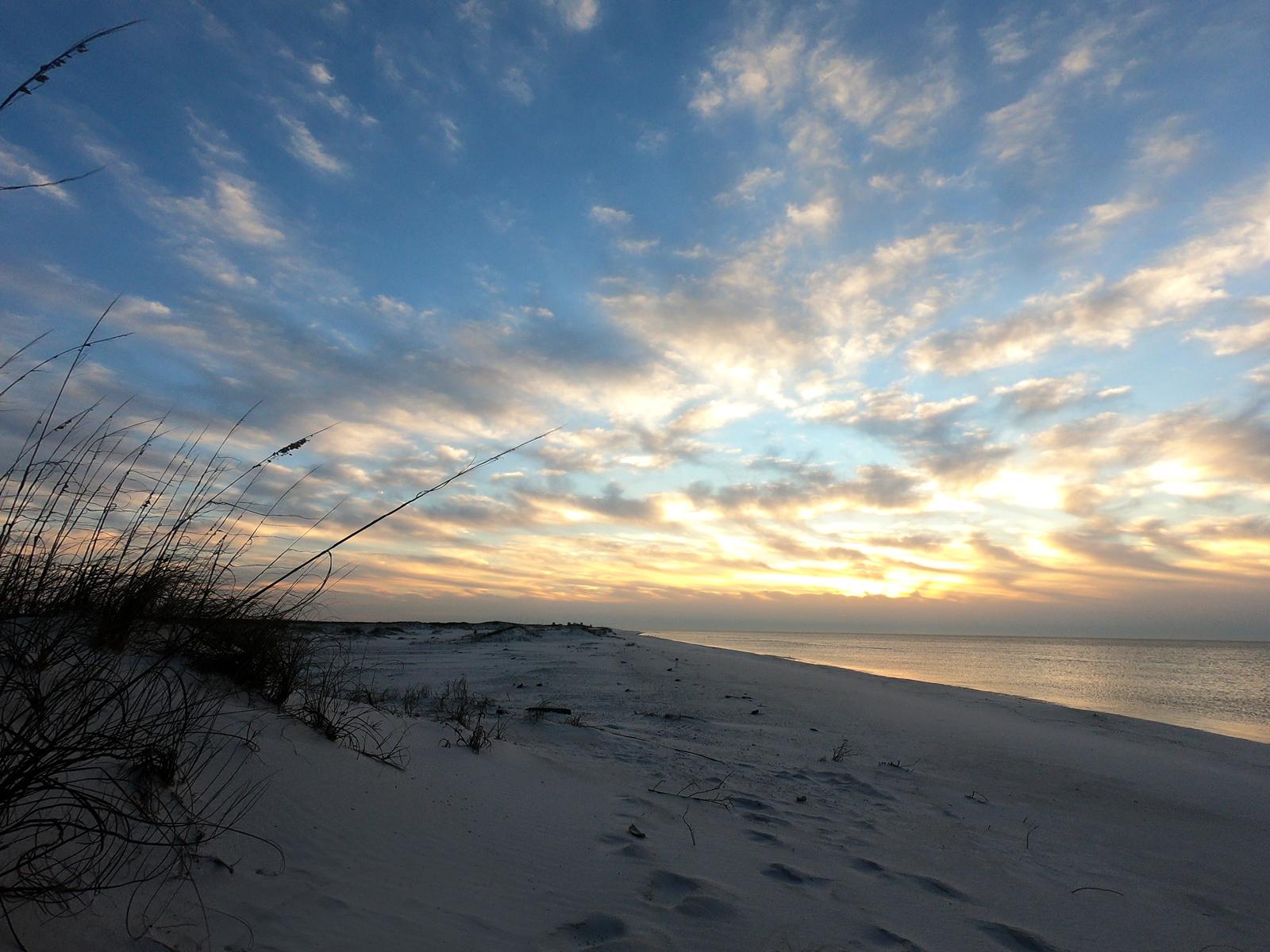 Sunrise at Gulf Islands National Seashore beach camping in Pensacola, Florida at Fort Pickens