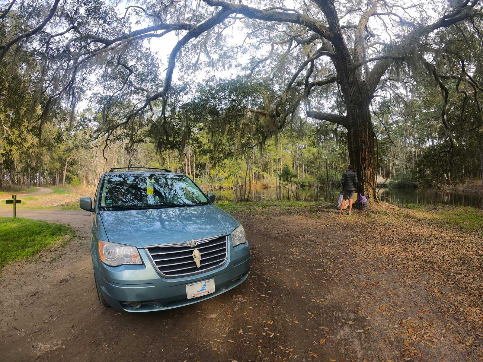 Van parked under a large live oak near Botany Bay pond at the Botany Bay Plantation, Edisto Island, SC
