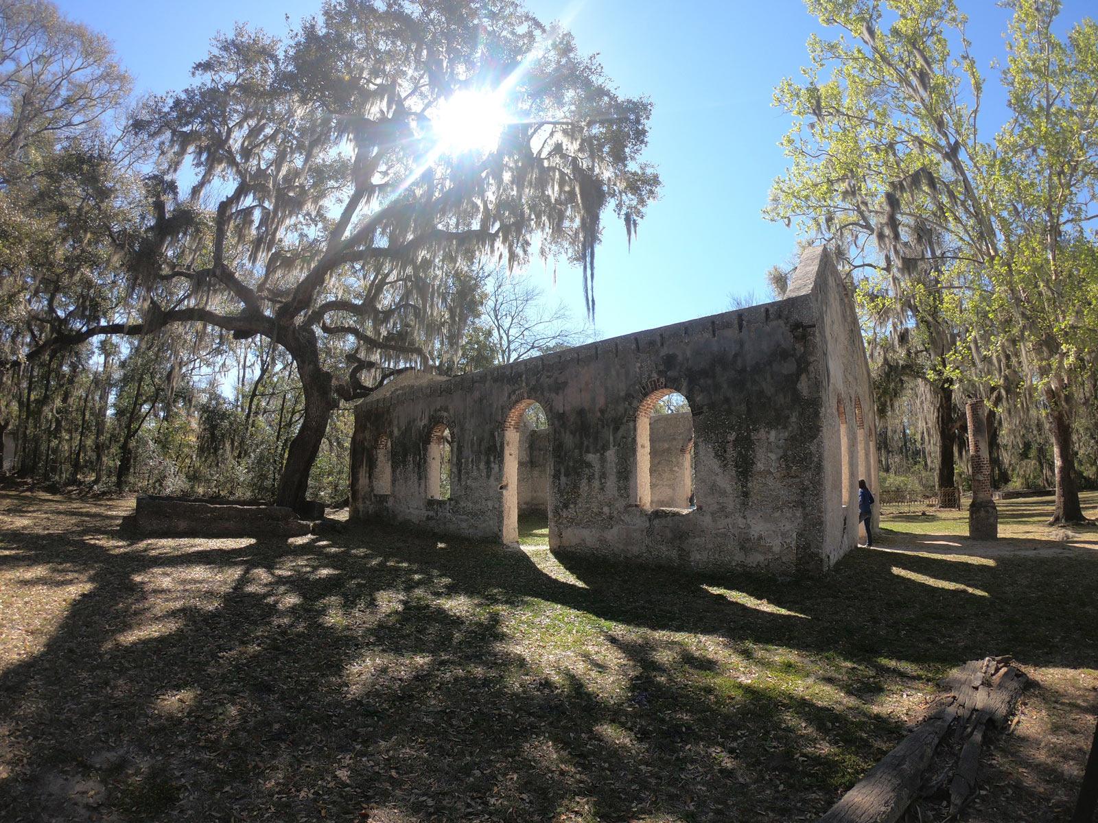 Ruins under Spanish moss laden live oak tree called Saint Helena Chapel of Ease outside of Beaufort, SC