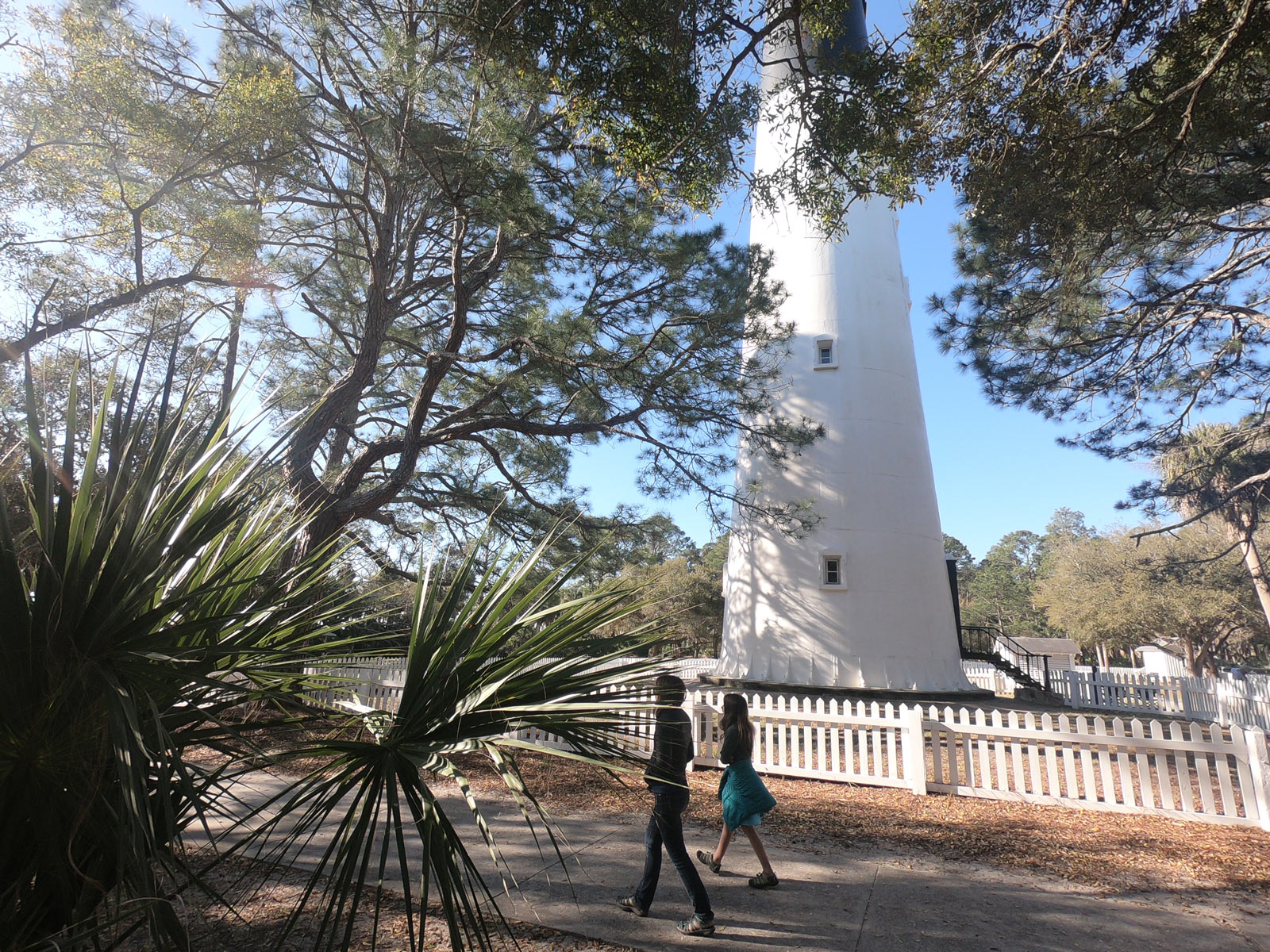 Two girls walking by the lighthouse at Hunting Island State Park, South Carolina