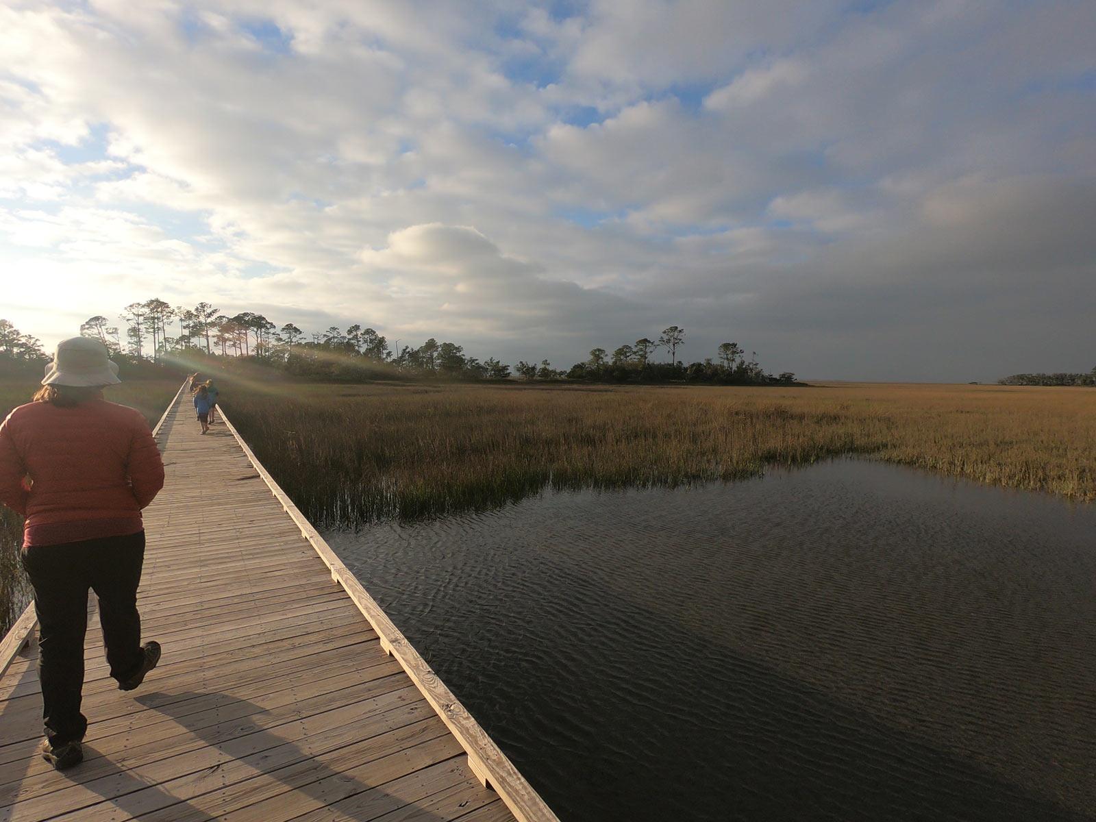 Walking the Marshwalk Boardwalk Trail at sunset on Hunting Island State Park, South Carolina