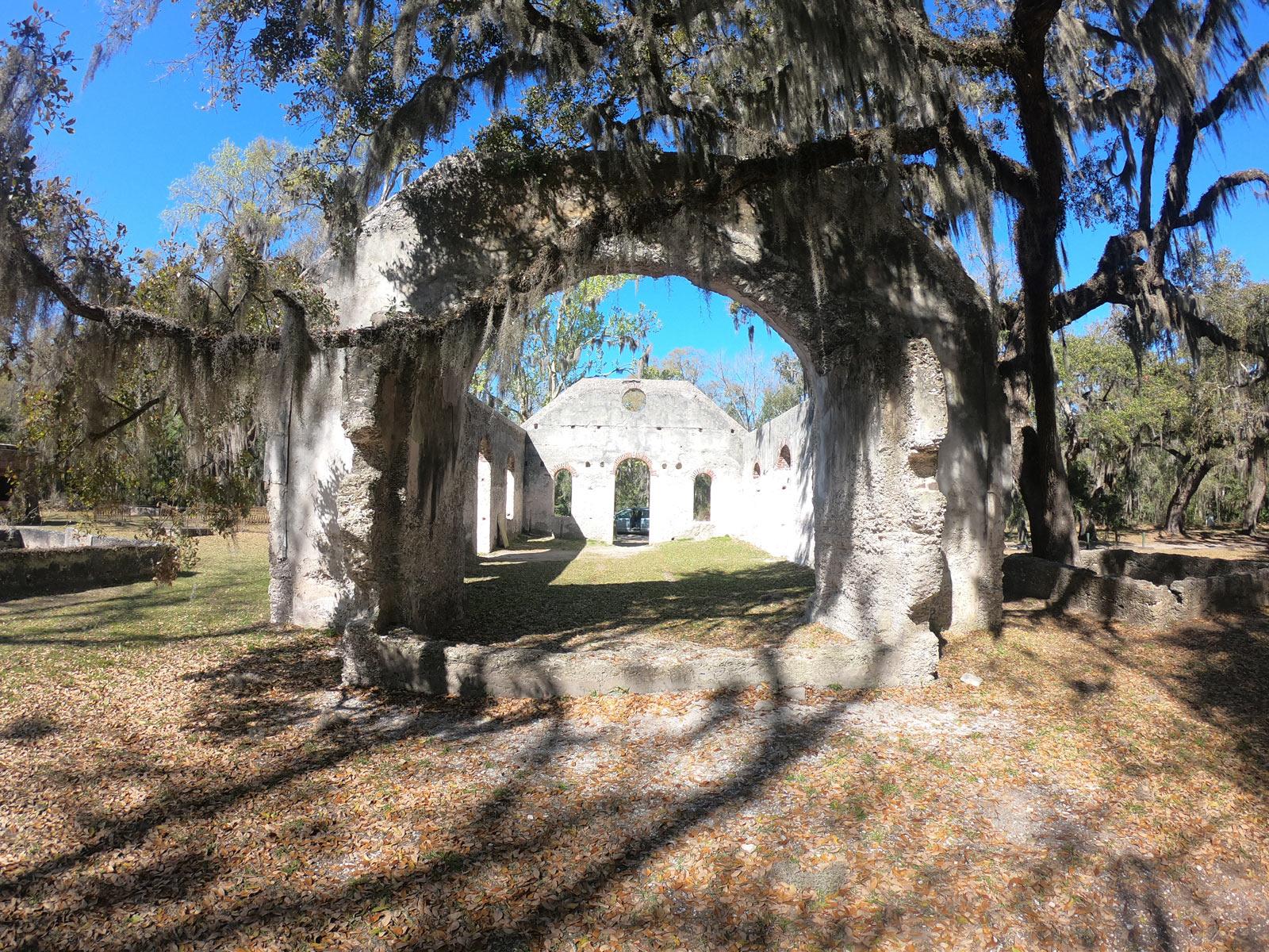 Chape of Ease ruins surrounded by blue sky, live oaks, Spanish moss near Beaufort, South Carolina