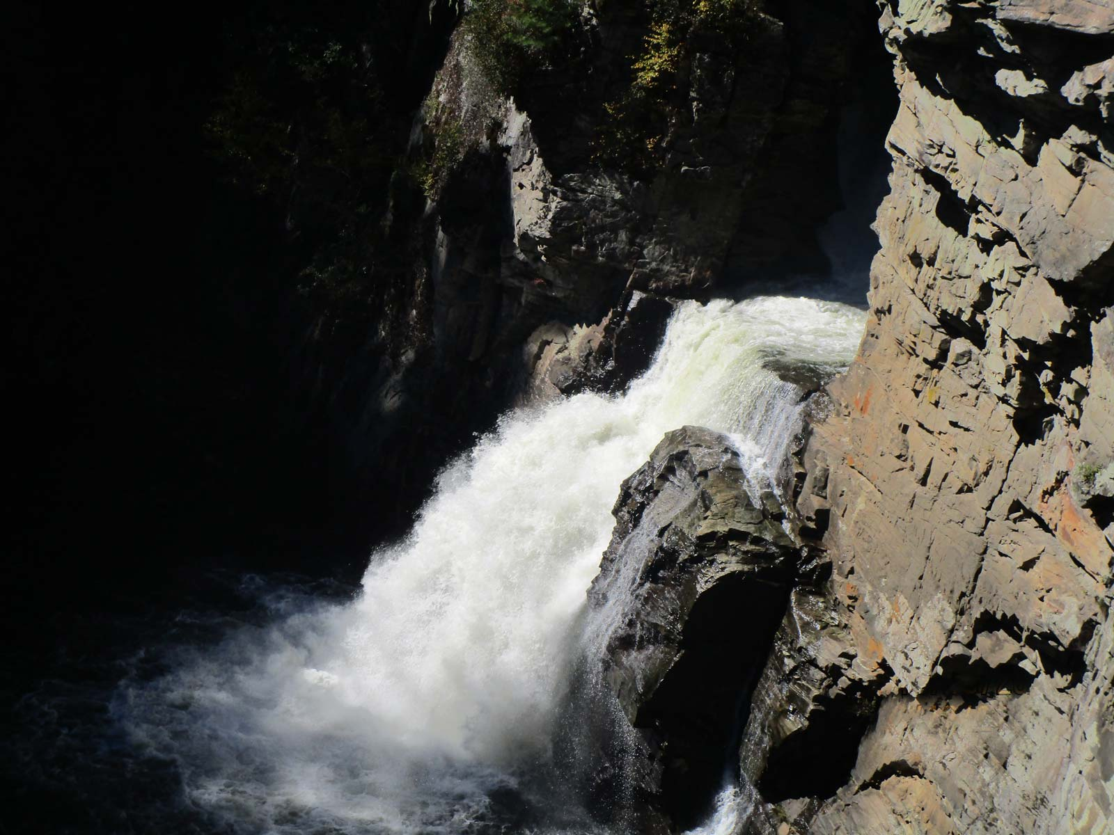 Hiking and viewing the rushing waters of overlook to Linville Falls Trail, off Blue Ridge Parkway, North Carolina