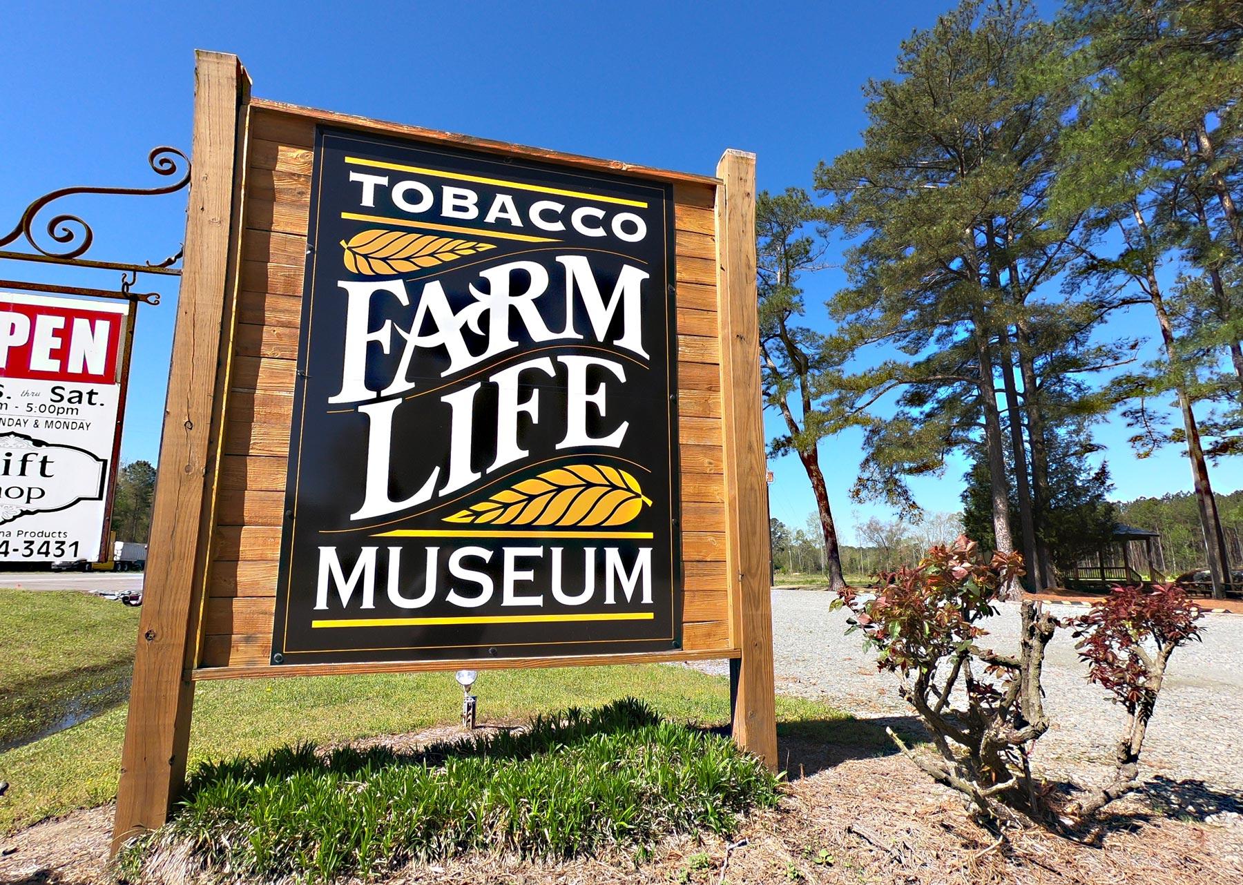 Road entrance signage and visit Tobacco Farm Life Museum, Kenly, North Carolina