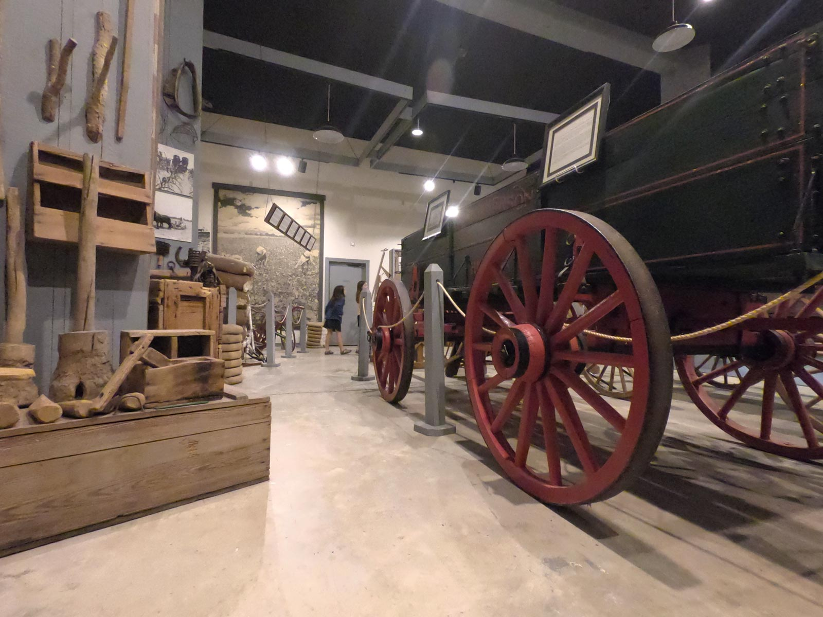 Visit the indoor exhibit of tools and wagons for tobacco farming at  the Tobacco Farm Life Museum, Kenly, North Carolina