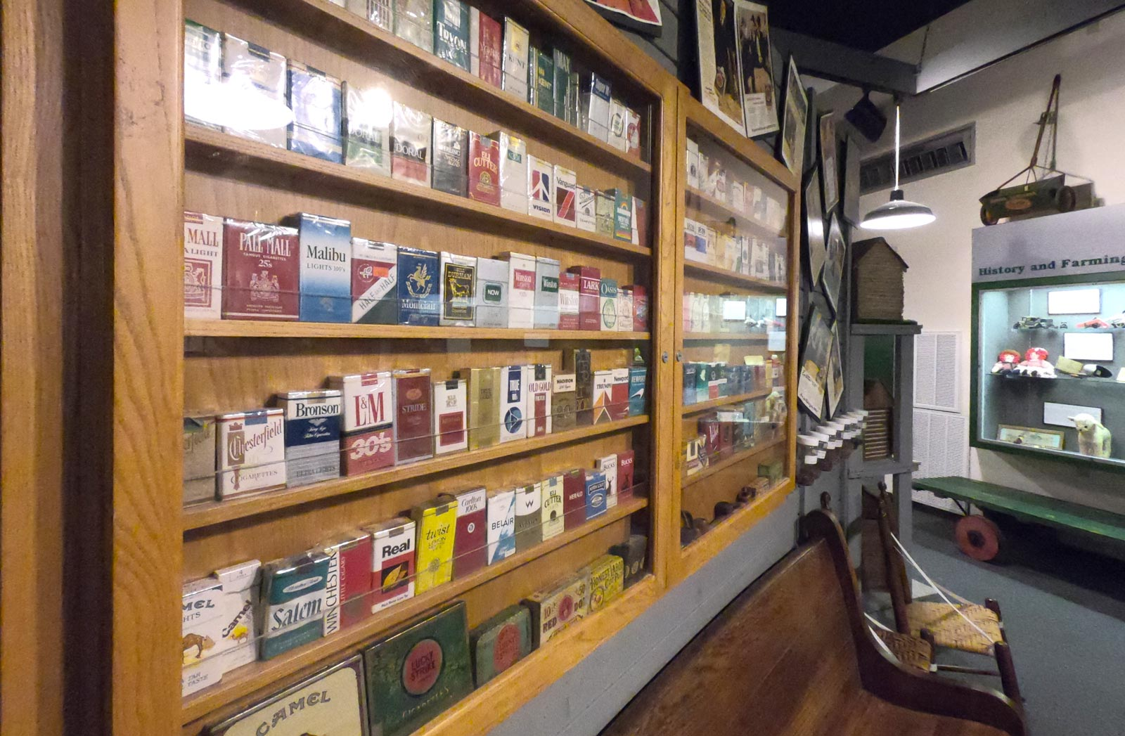 Visit the indoor exhibit featuring different brands of cigarette packs at Tobacco Farm Life Museum, Kenly, North Carolina