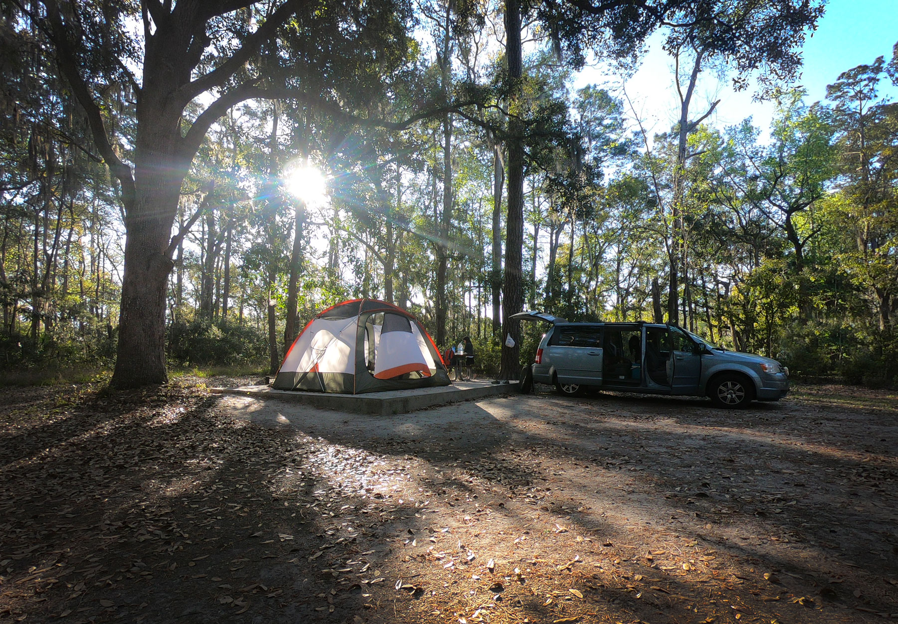 Setting up spacious campsite with tent and van while camping at Skidaway Island State Park, Georgia
