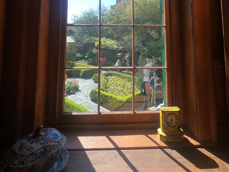 Interior window overlooking the courtyard gardens of Owens-Thomas House & Slave Quarters in Savannah, Georgia