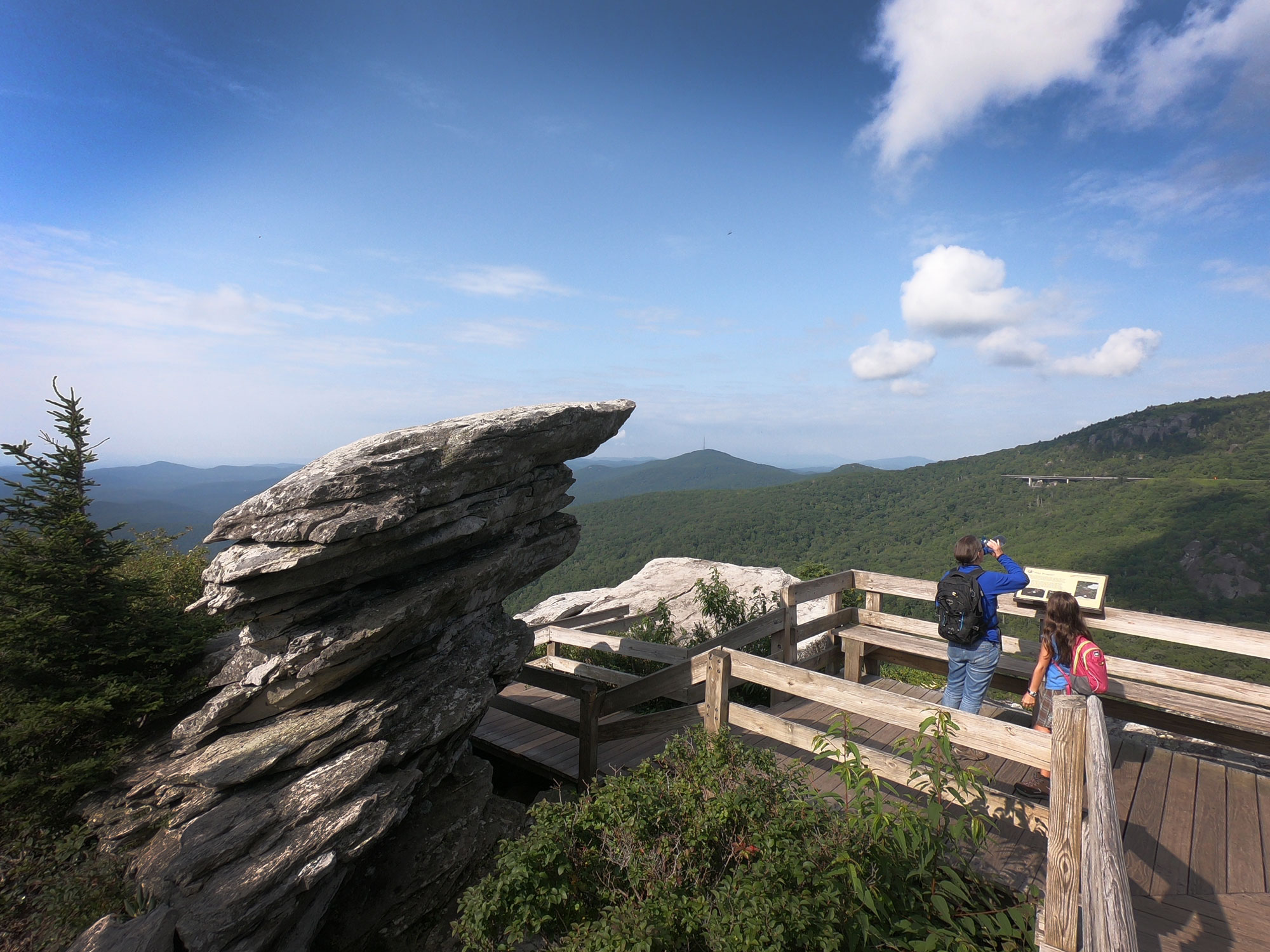 Two people on the overlook deck on Rough Ridge Trail, off Blue Ridge Parkway, North Carolina