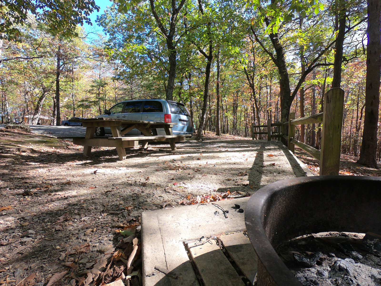 Van, picnic table, and fire ring at campsite in Hanging Rock State Park, North Carolina
