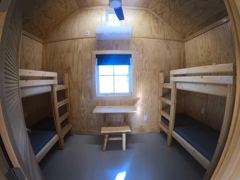 Interior view of both bunk beds and desk in camping cabins at Goose Creek State Park, North Carolina