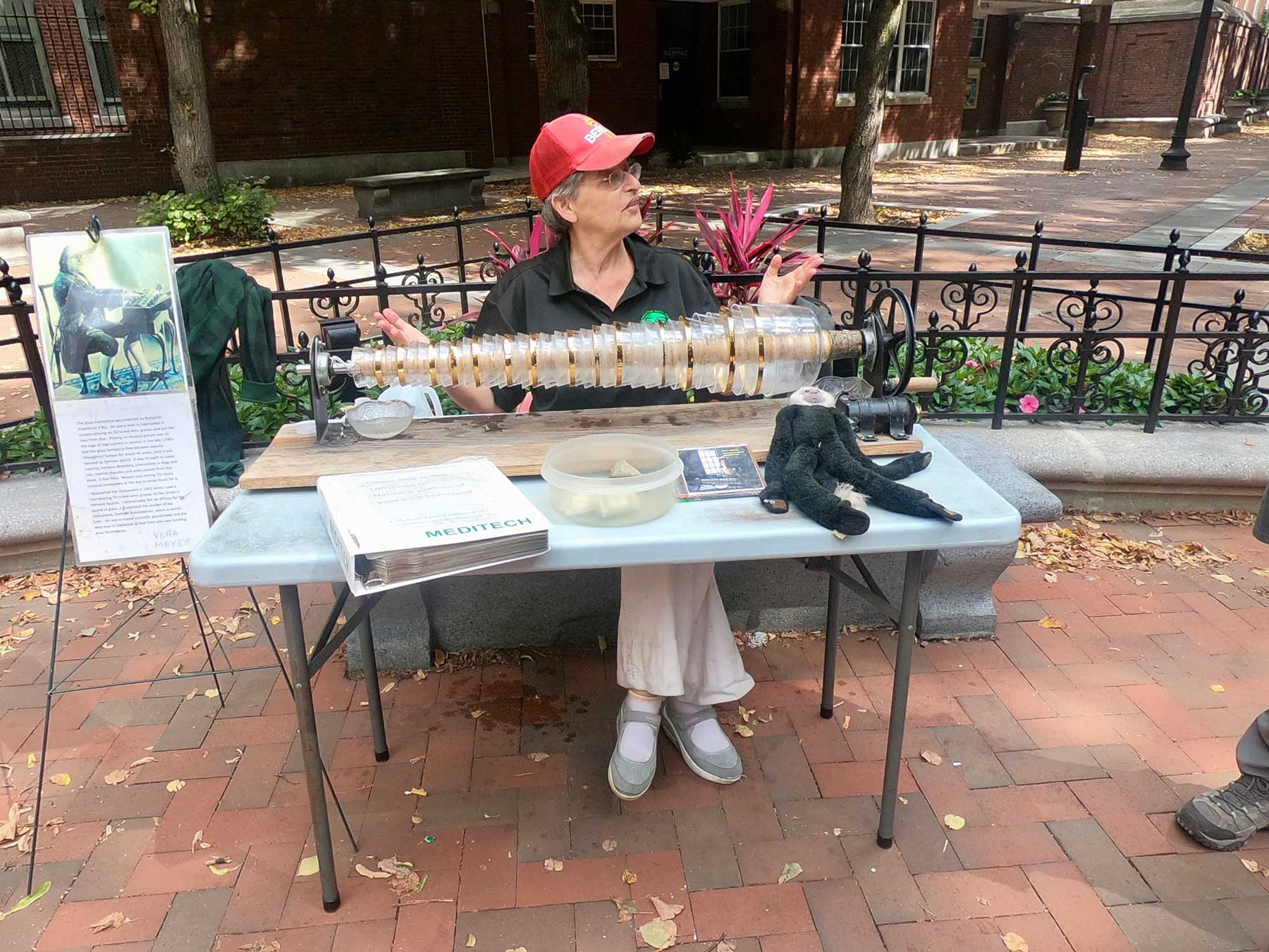 Vera Meyer playing armonica at the Paul Revere Mall on Freedom Trail in Boston, Massachusetts