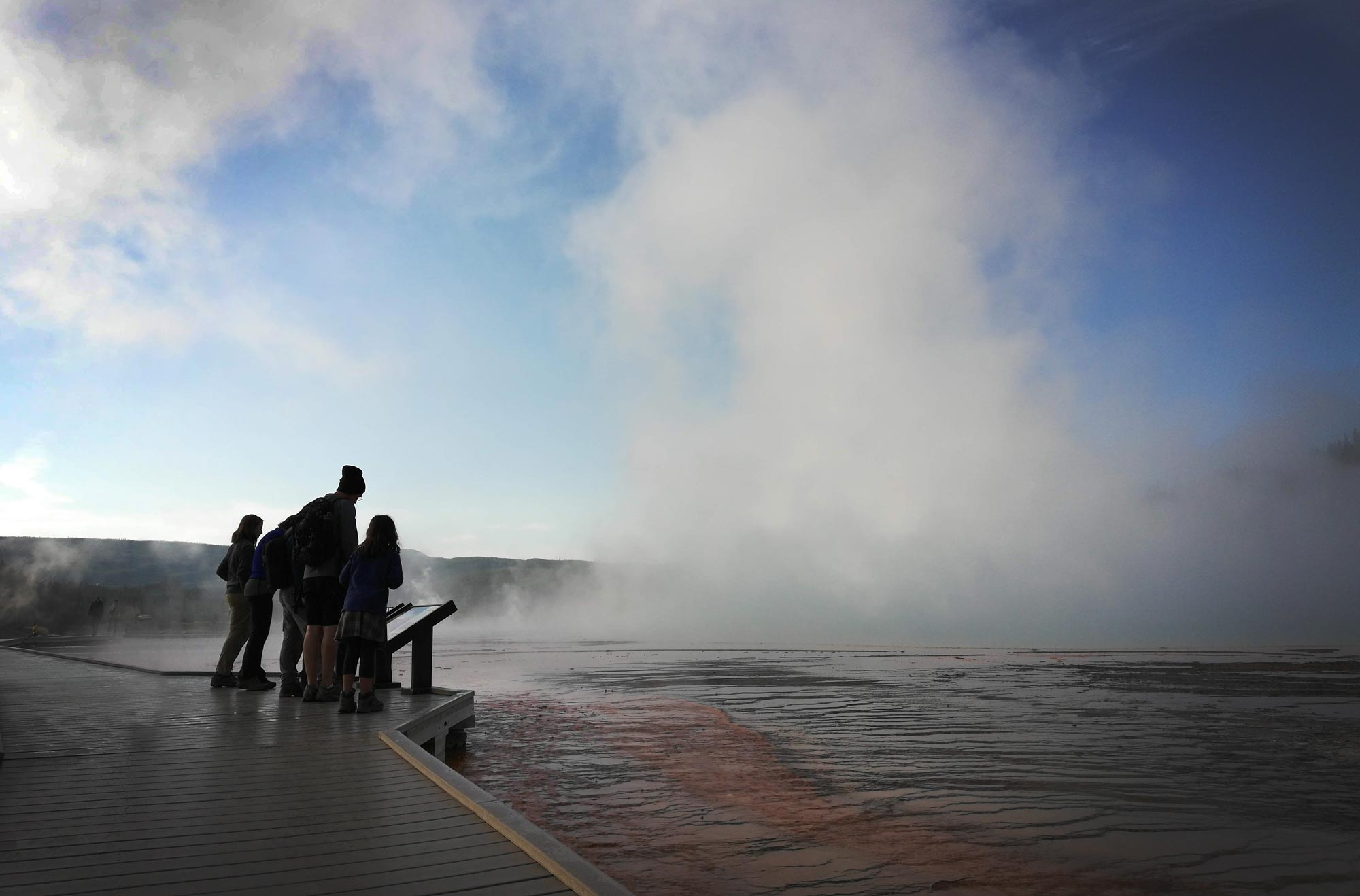 Grand Prismatic Hot Spring in early mist in Yellowstone National Park