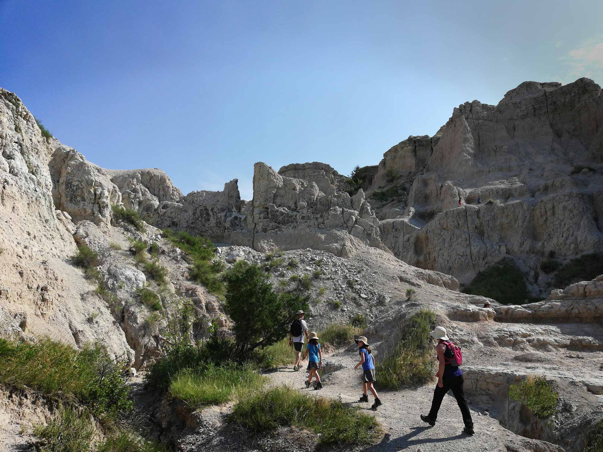 Family hiking the Notch Trail in Badlands National Park, South Dakota