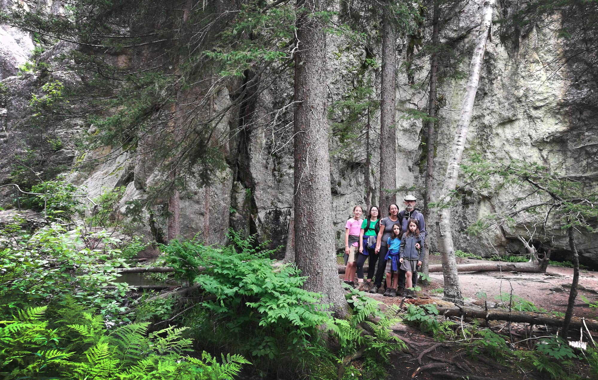 Family hiking the Sunday Gulch Trail in Custer State Park, South Dakota