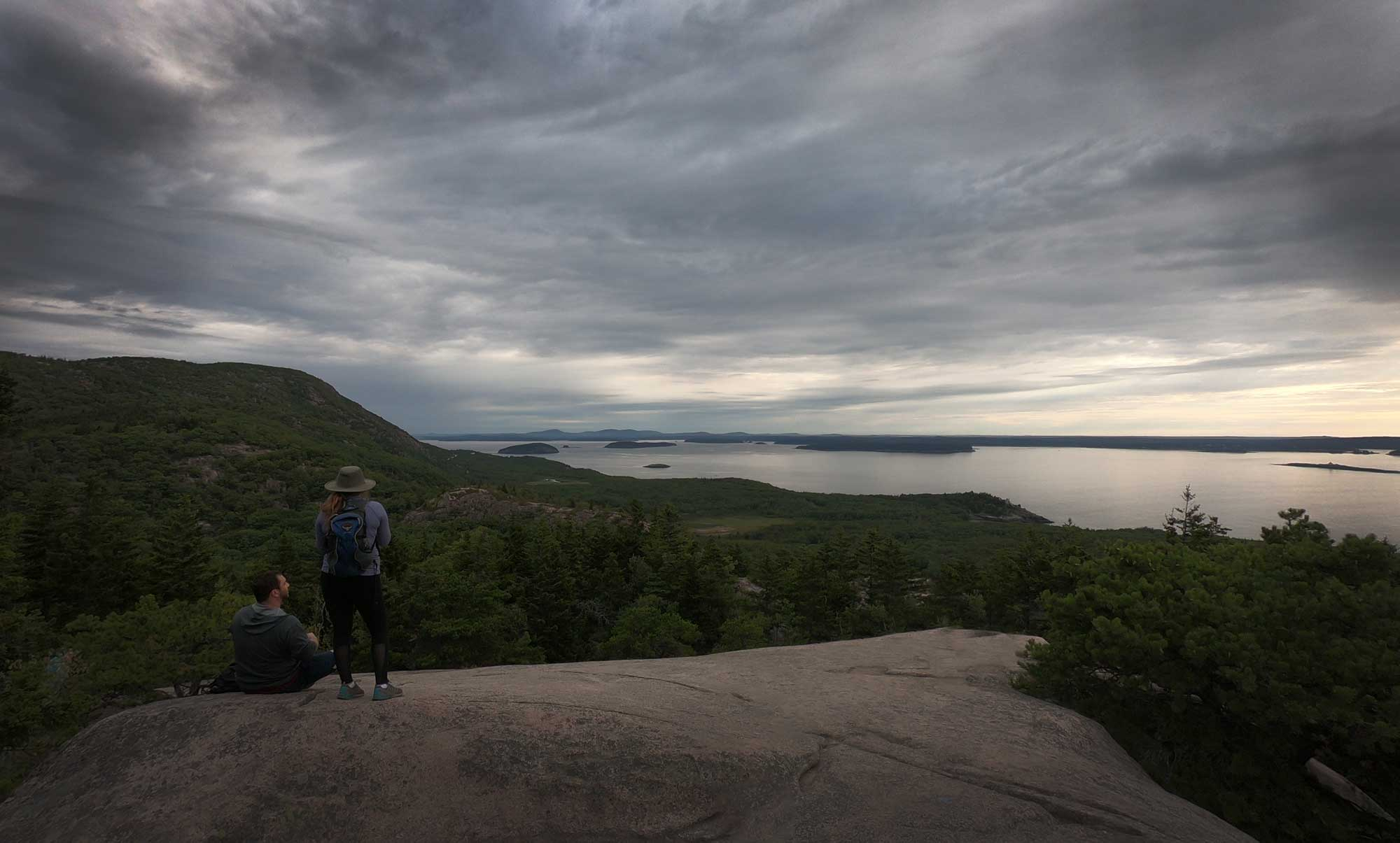 Two hikers at the summit of the Beehive Trail, Acadia National Park, Maine