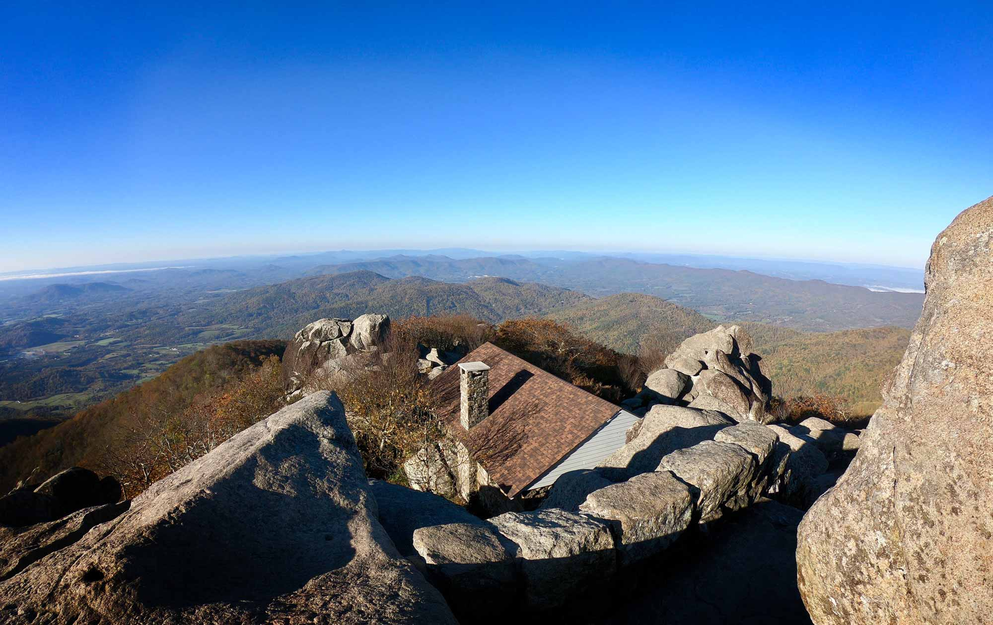 Summit view on Sharp Top Trail overlooking stone shelter near Peaks of Otter on Blue Ridge Parkway, Virginia