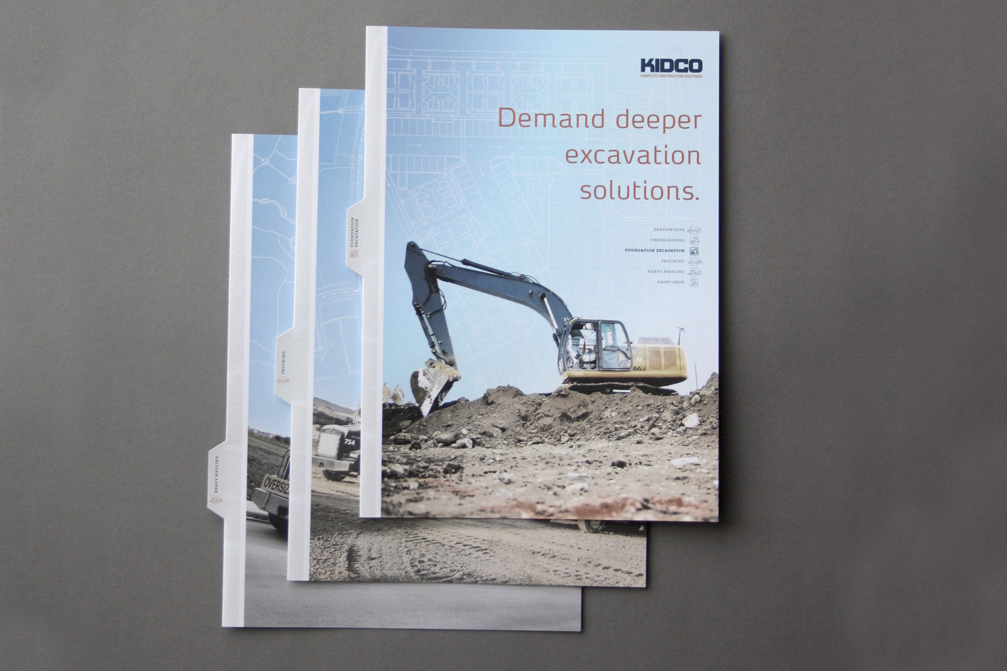 Brochure cover design showing excavator for Kidco Construction in Calgary by Studio Forum