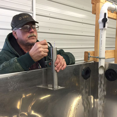 staff check on syrup evaporator