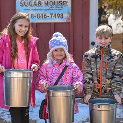 kids showing collected sap