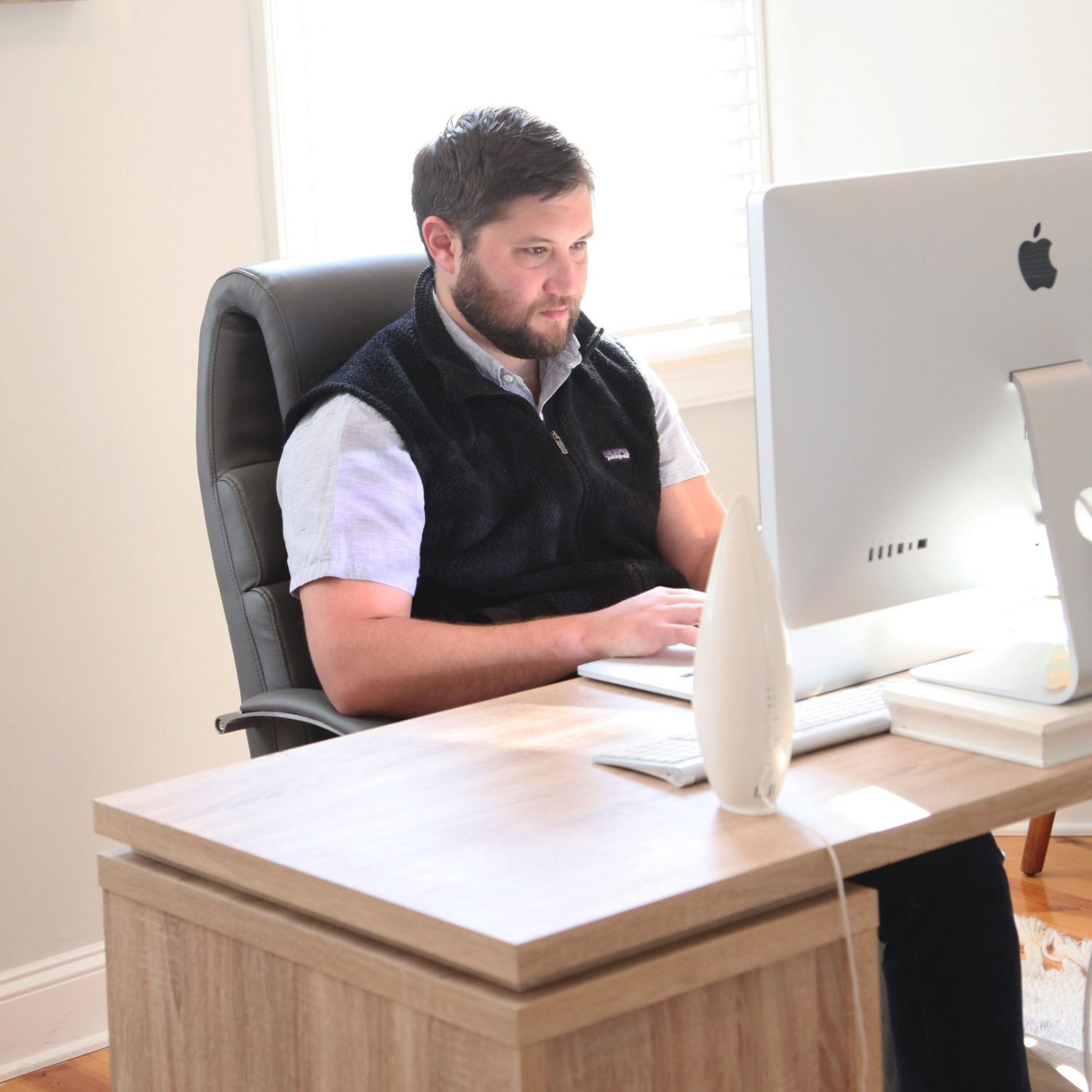 Chris Simon, the Accounting Manager working at his computer