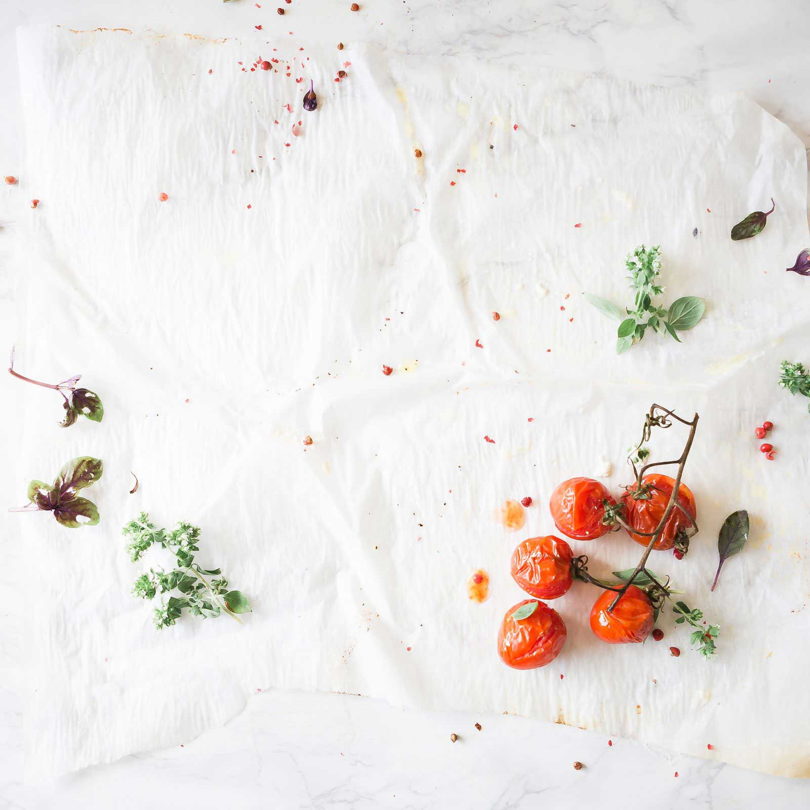 Tomatoes and herbs on a cloth