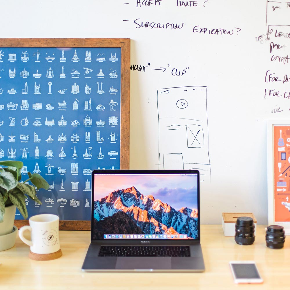 Desk with a laptop and other office supplies