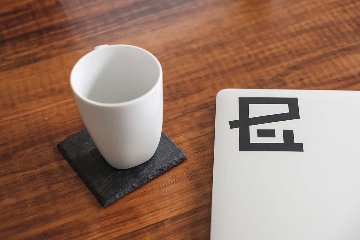eHouse logo next to a coffee mug